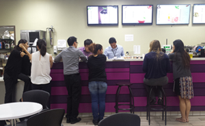 Lollicup employees observe as a fellow Boba 101 student makes a beverage.